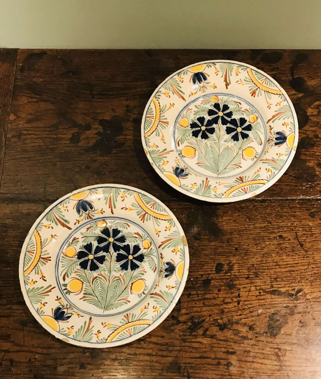 A pair of 18th c Dutch Delft polychrome plates