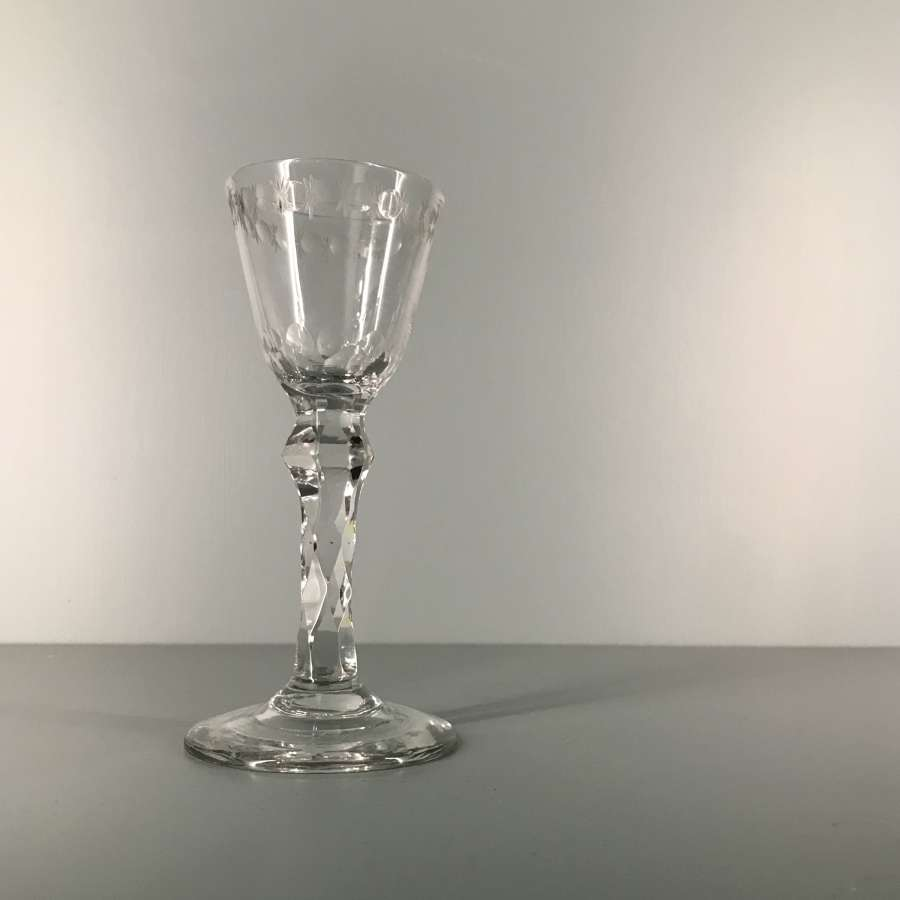 18th c. cordial glass with facet stem