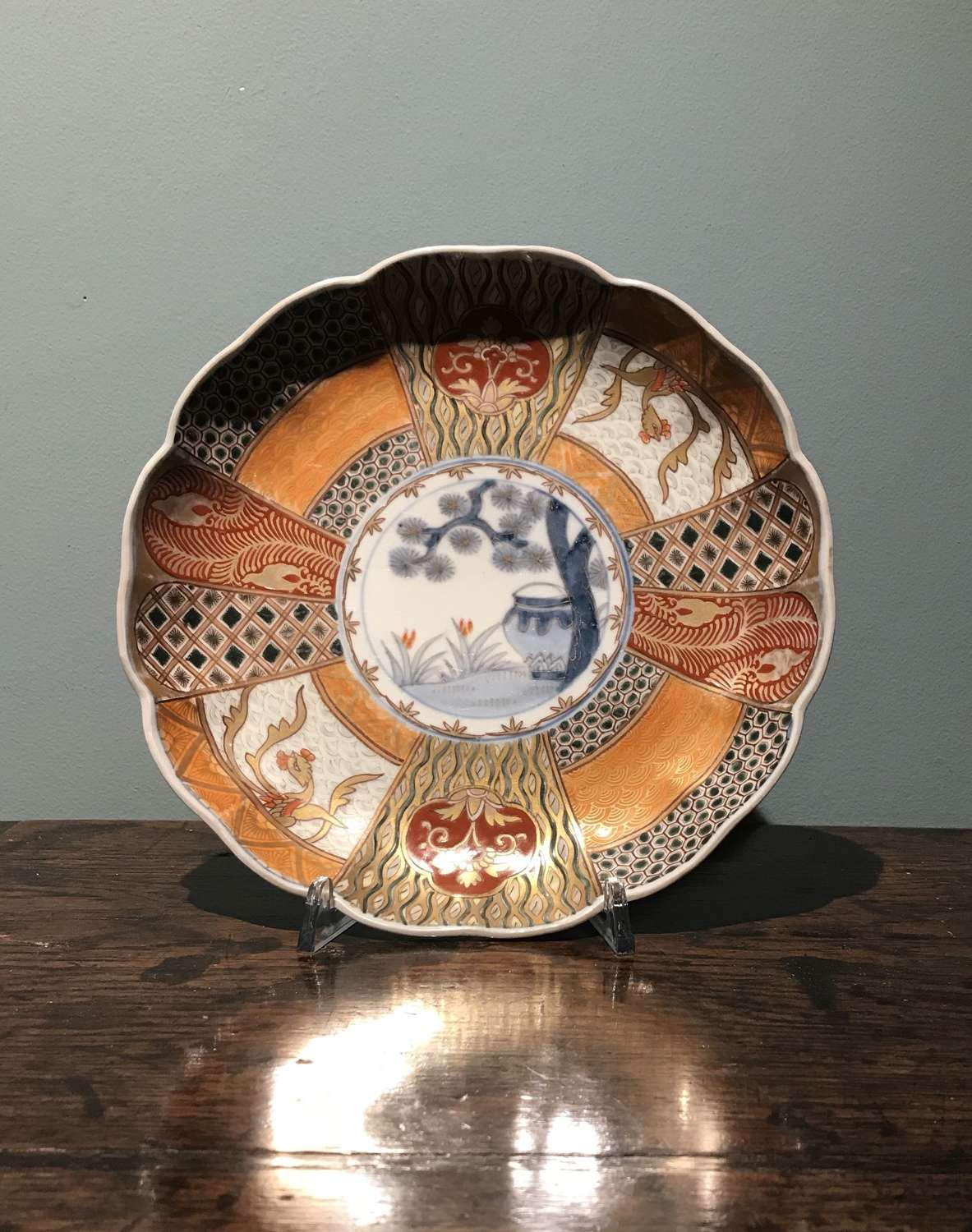 Edo period Japanese plate with pine tree and vase motif
