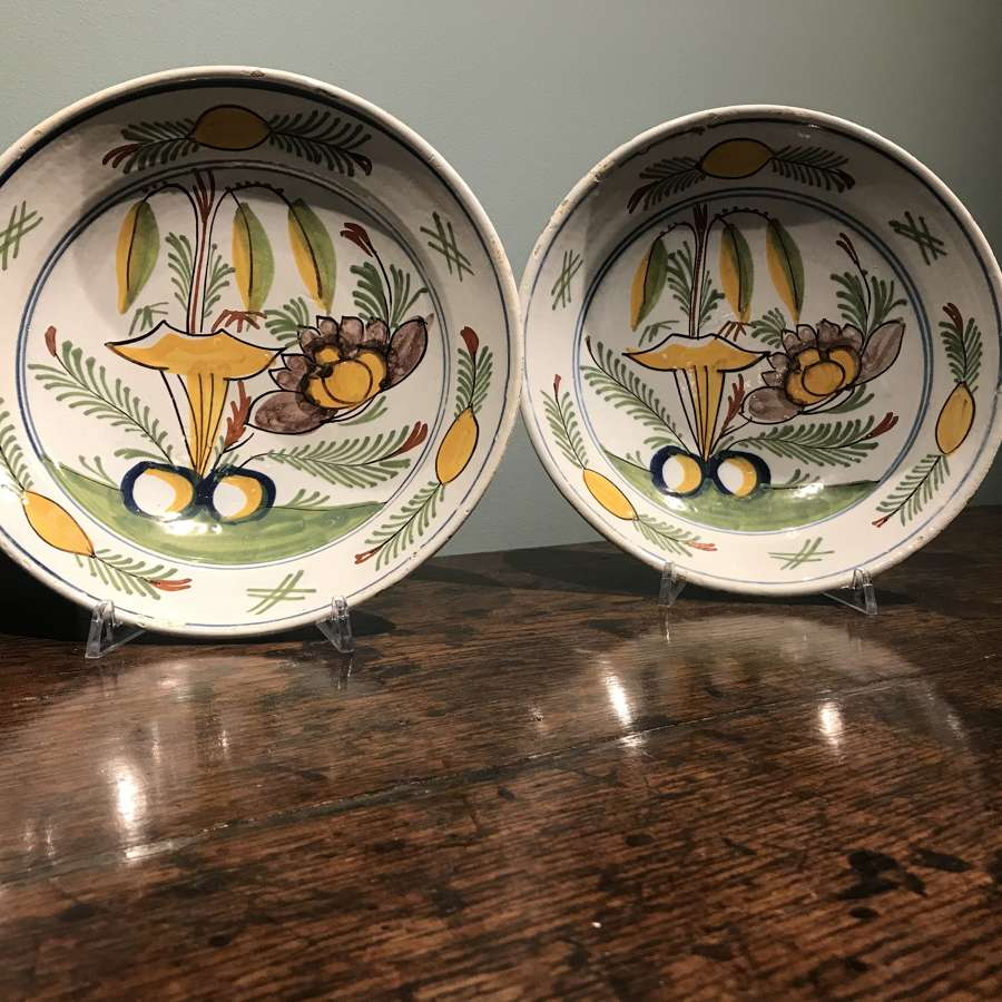 A pair of Dutch Delft polychrome dishes