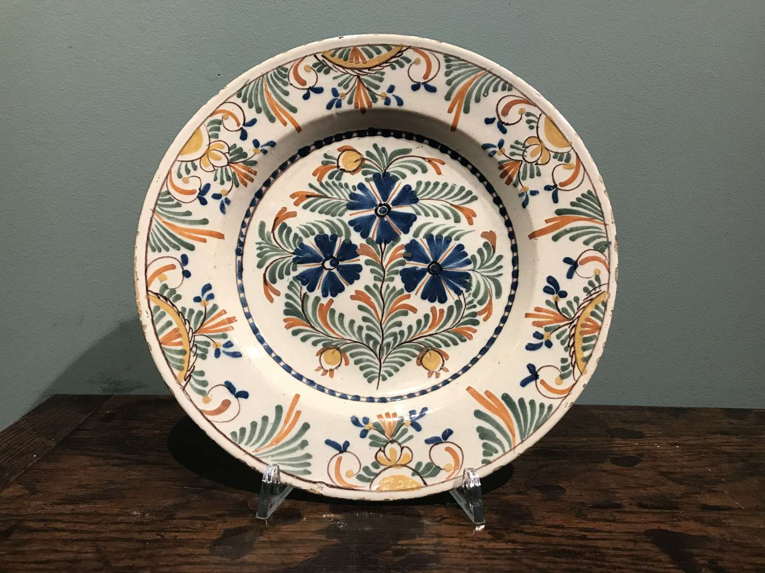 A mid 18th c. Dutch Delft polychrome plate