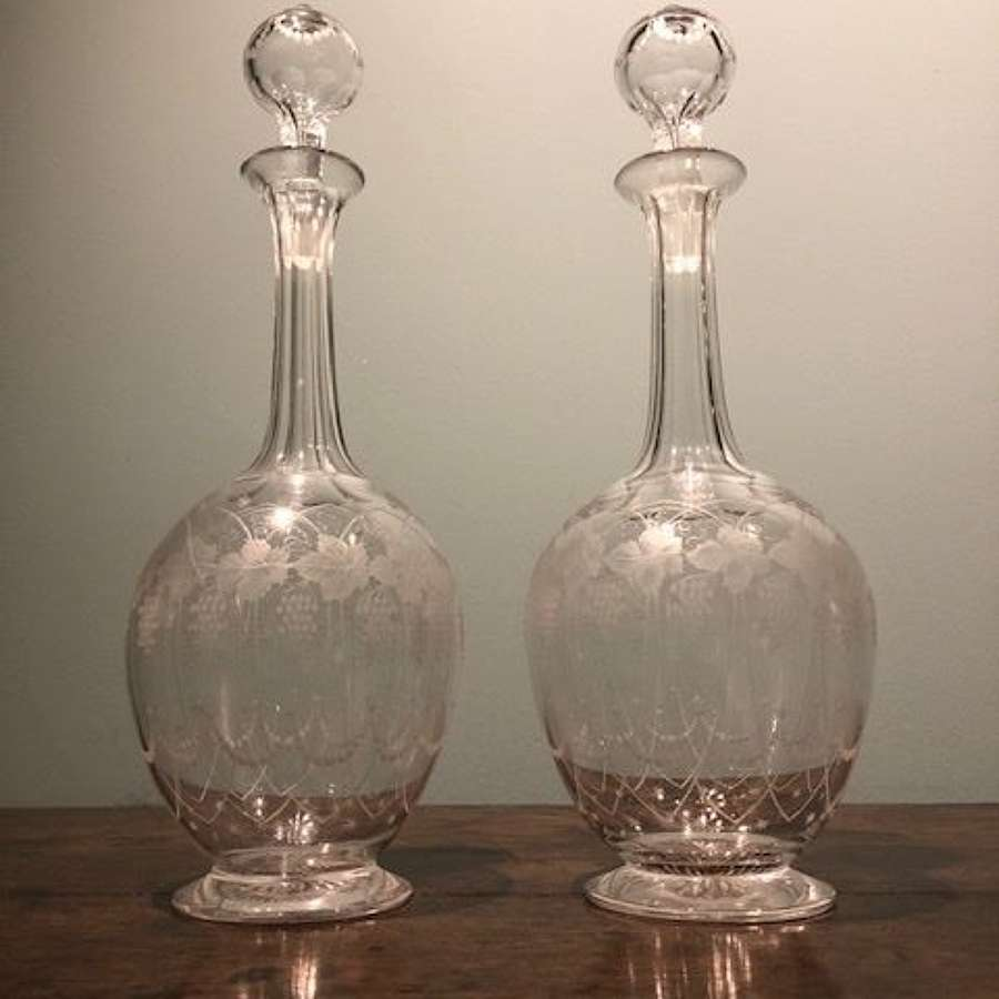 A PRETTY PAIR OF 19TH C. ENGRAVED DECANTERS