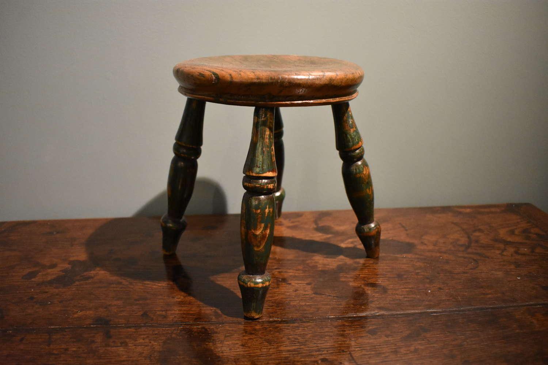 19th c. round stool in elm