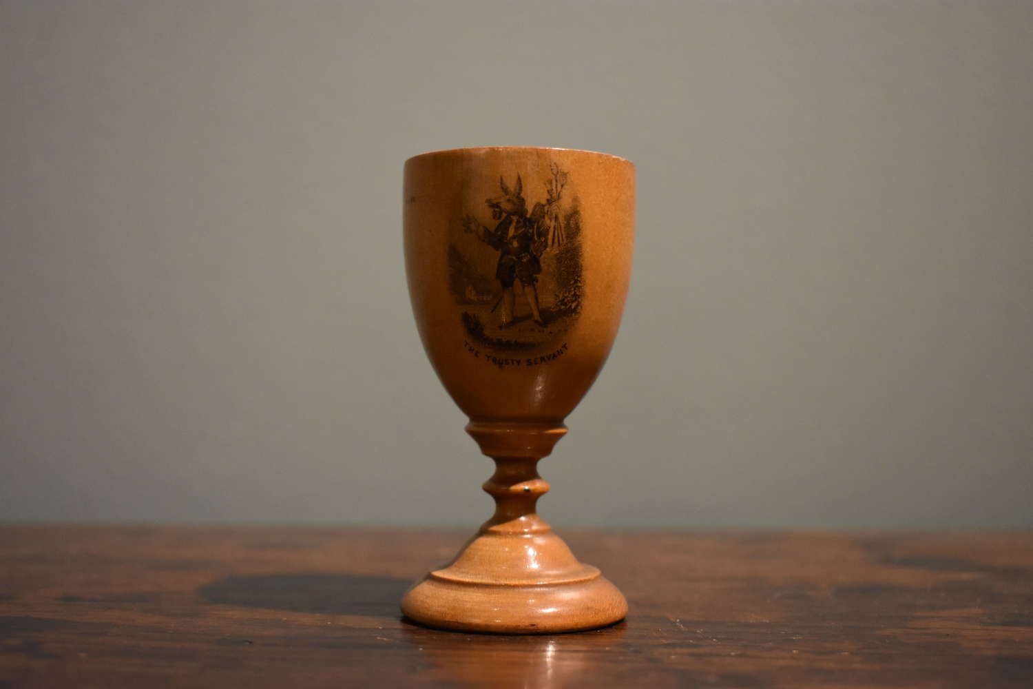 19th c. Mauchline ware Egg Cup depicting 'The Trusty Servant'