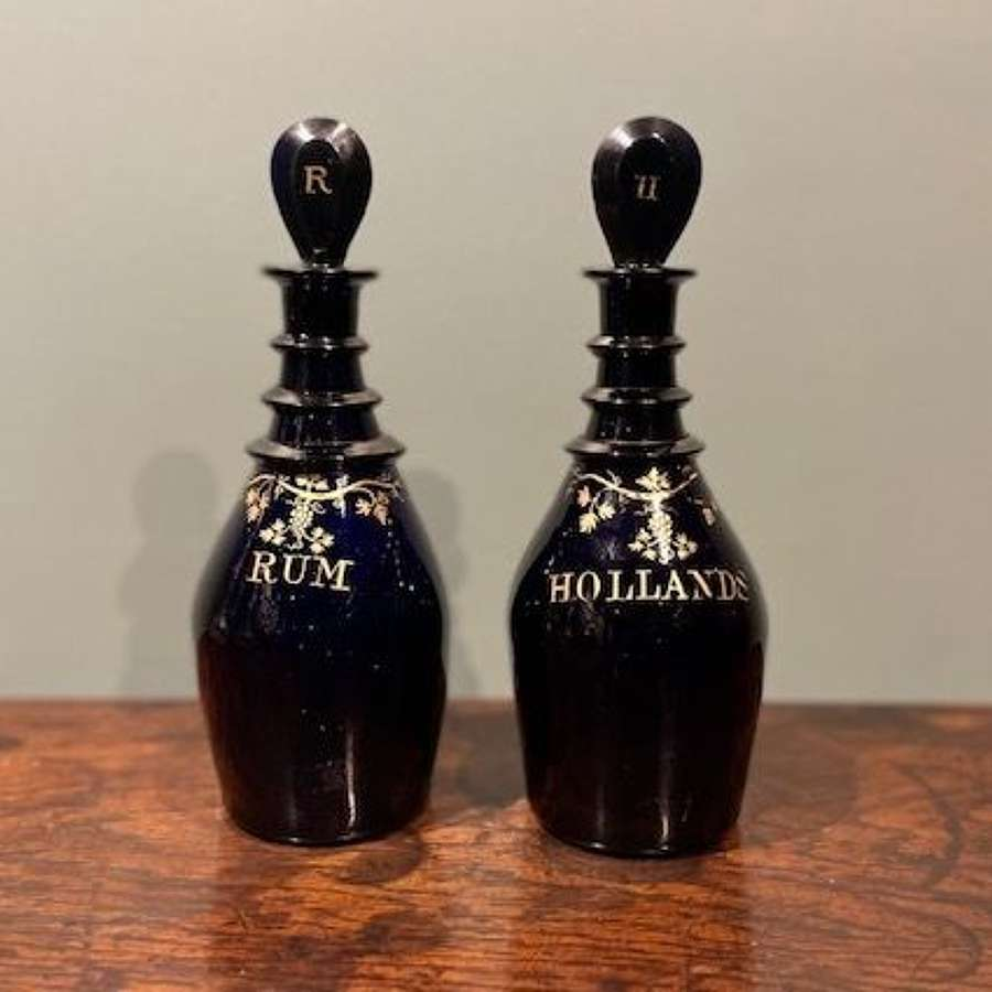 A pair of Regency 'Bristol blue' spirit decanters - Rum and Hollands