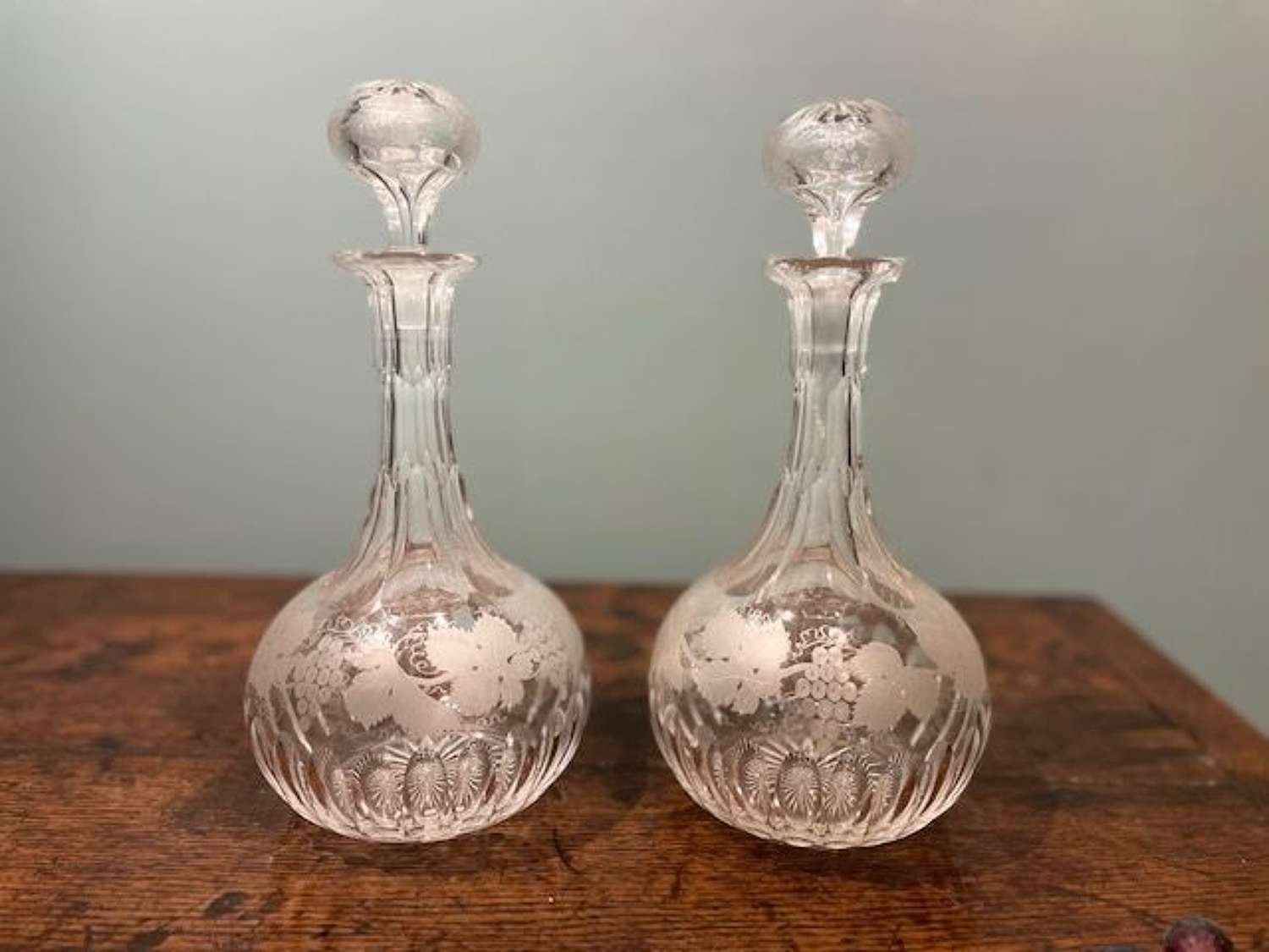 Pair of mid 19th c. Shaft & Globe decanters with grapevine motifs