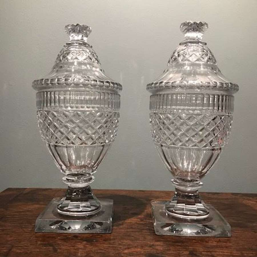 Pair of Irish Georgian glass urns and covers