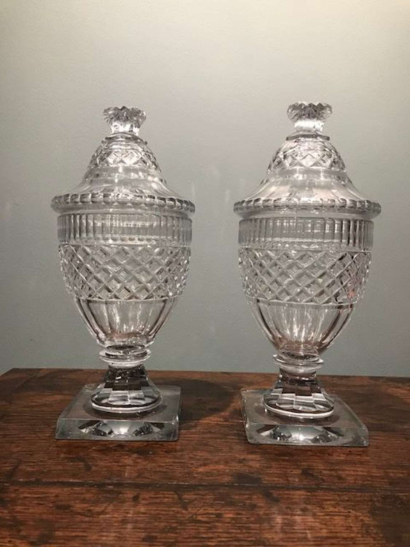 Pair of Irish Georgian glass urns and covers
