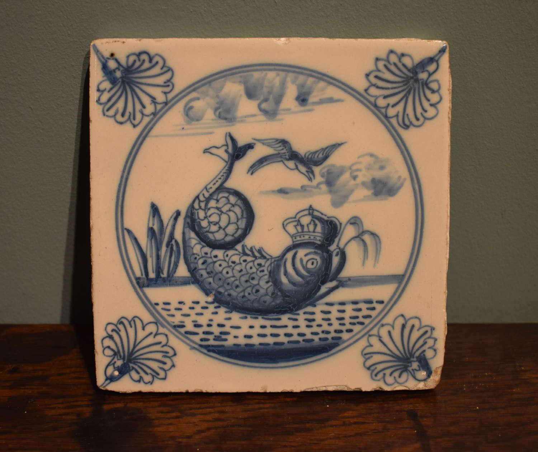 Rare, 18th c. Dutch Delft tile - 'Fish with Crown'